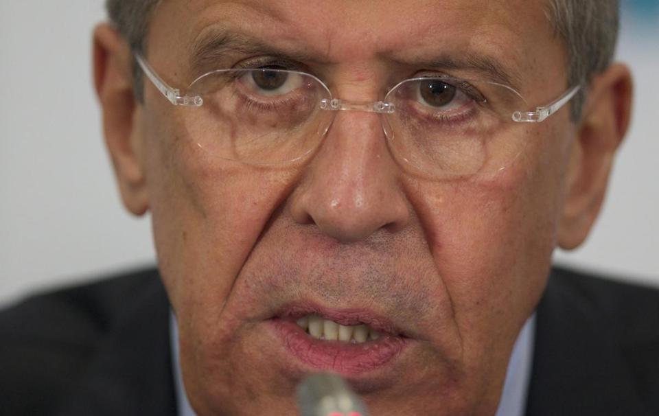 Russia's foreign minister on Wednesday promised a firm response if its citizens or interests come under attack in Ukraine.