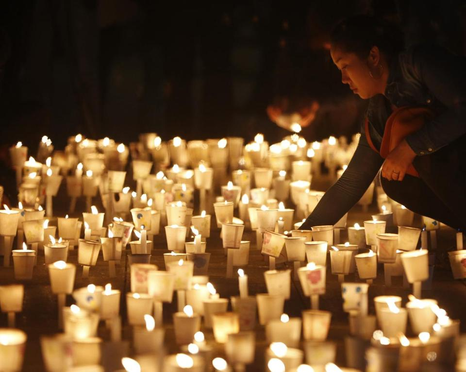A woman attended a candlelight vigil in Ansan, to commemorate the victims of capsized passenger ship.