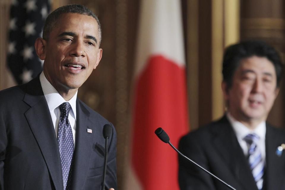 President Obama (left) and Japanese Prime Minister Shinzo Abe appeared Friday at joint news conference in Tokyo.