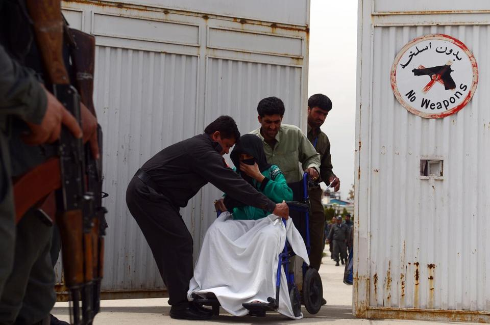 Afghan hospital attendants helped a patient after a shooting at a hospital in Kabul.