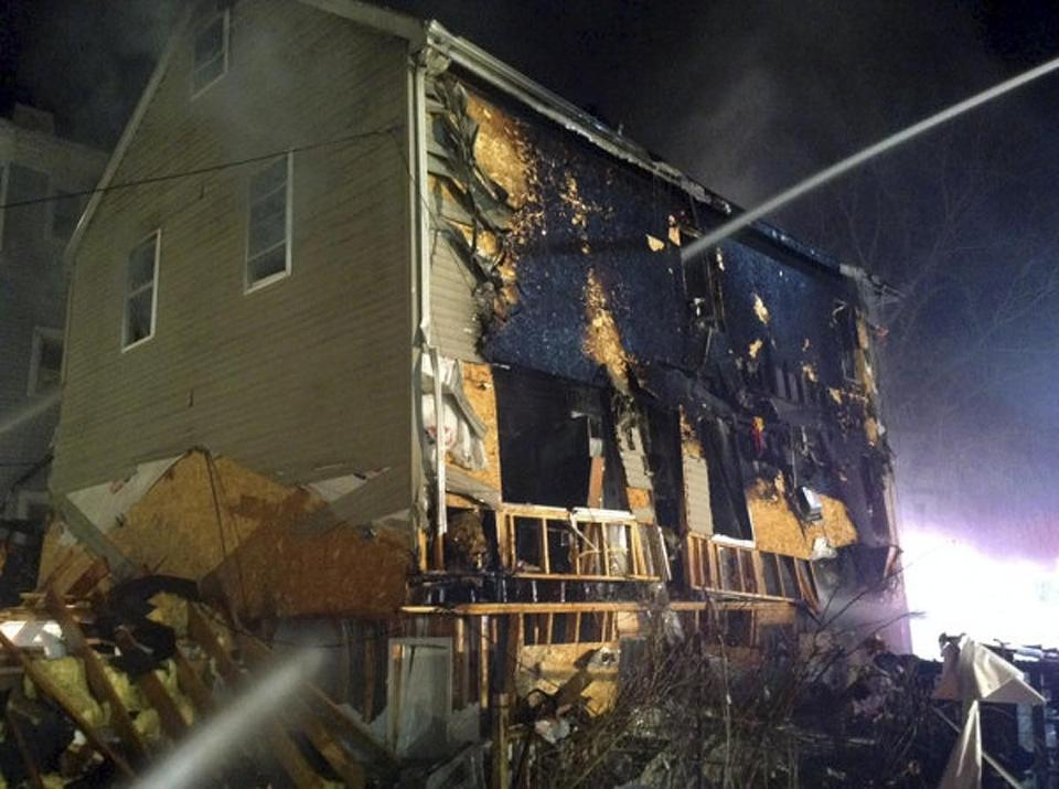 An explosion in a Dorchester home critically injured two people and hurt nine others.