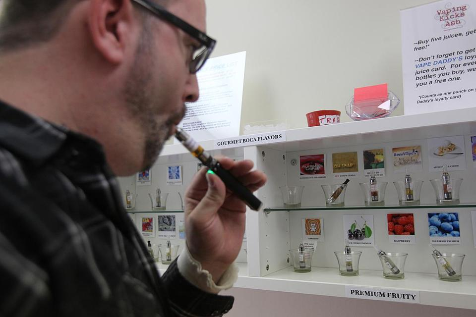 Steve Halligan, a pack-a-day smoker, tries out some sample flavors at Vape Daddy's in Newton. At first skeptical, he left the store after buying two blends.