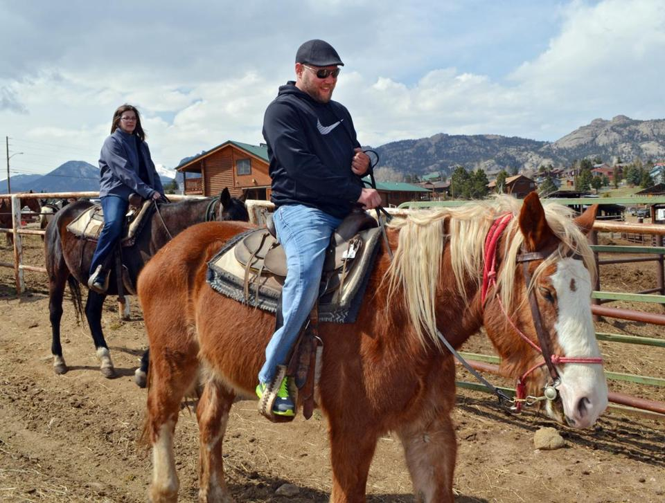 Riding ranches are using more draft horses like Joker (ridden by Christian Styles) as US obesity rises.