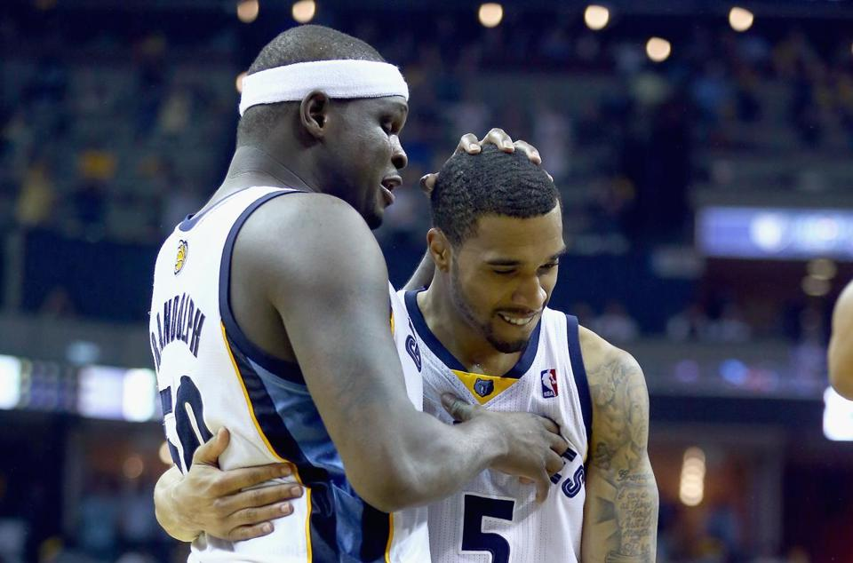 Zach Randolph congratulates Mike Conley, who scored 5 of his 20 points in overtime for the Grizzlies. (Photo by Andy Lyons/Getty Images)