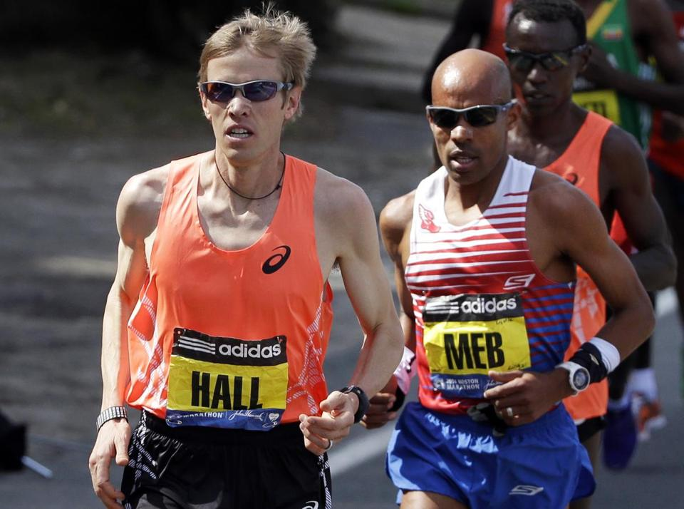 Ryan Hall, left,  runs near Meb Keflezighi. along the route.