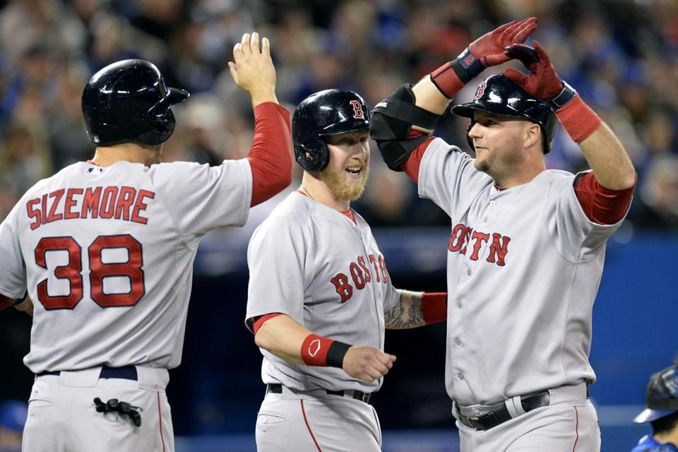 A.J. Pierzynski, right, was congratulated by Mike Carp and Grady Sizemore after hitting a grand slam in the third inning.