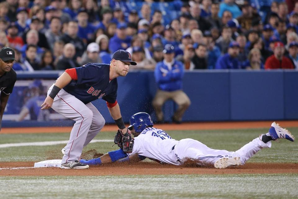 Third baseman Will Middlebrooks applies the tag as the Blue Jays' Jose Bautista is thrown out trying to steal in the fourth inning. (Photo by Tom Szczerbowski/Getty Images)