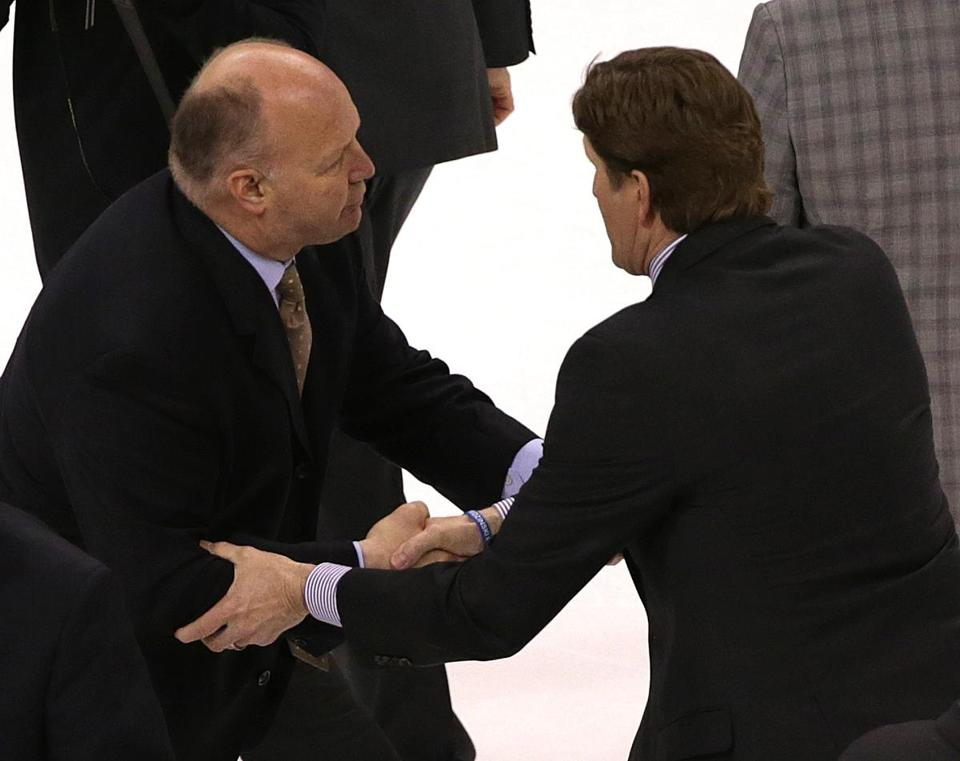 Bruins coach Claude Julien shakes hands with Detroit counterpart Mike Babcock following Game 5. (Barry Chin/Globe Staff)