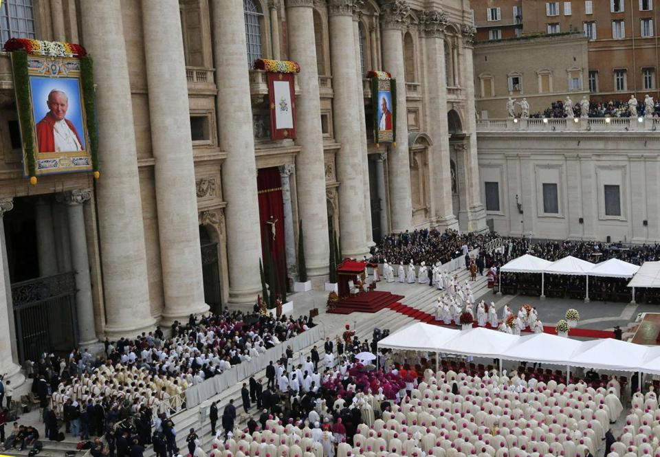 Tapestry portraits of Pope John Paul II and Pope John XXIII hung over St. Peter's Square.