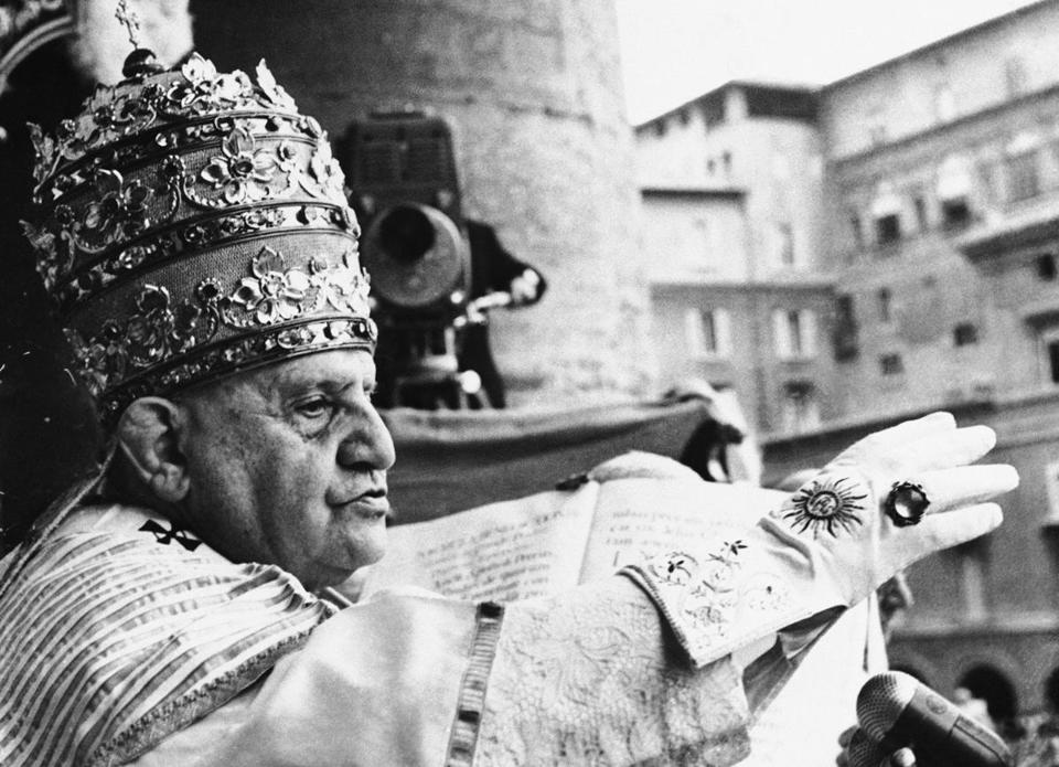 Pope John XXIII, just after being crowned pontiff, raised his hand in blessing at the Vatican on Nov. 4, 1958.