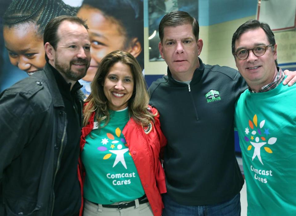 From left: Bob Wahlberg, Sandra Lopez Burke, executive director of City Year, Mayor Marty Walsh, Tim Murnane, Comcast vice president.