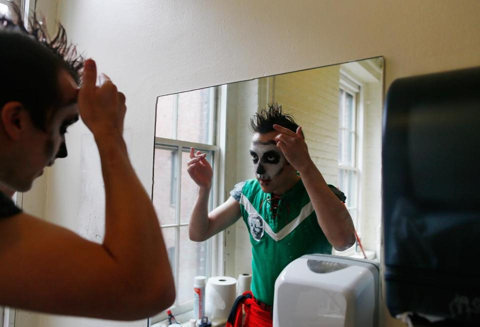 Kyle Hamilton, of Natick, applies makeup before auditioning  this past month for a role in King Richard's Faire. He was awarded an apprenticeship for the Carver festival.