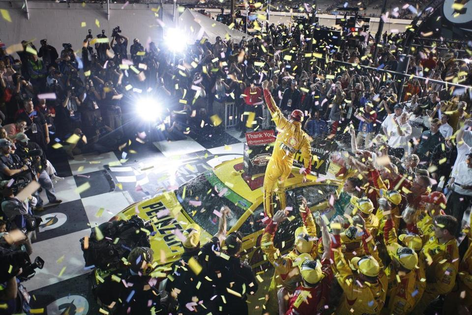 Joey Logano celebrates in Victory Lane after winning the NASCAR Sprint Cup race at Richmond International Raceway.