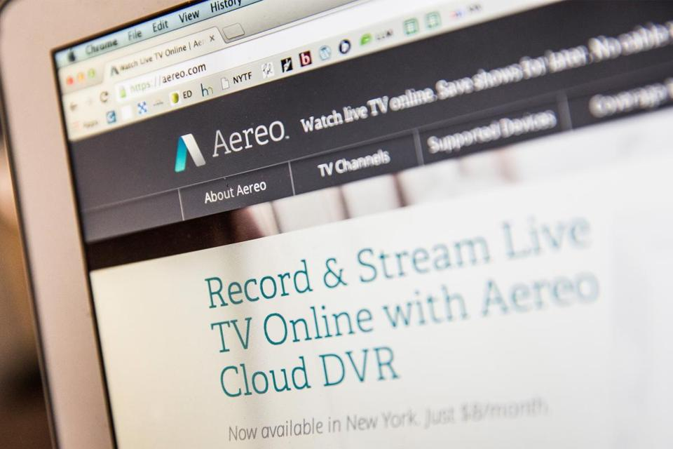 In this photo illustration, Aereo.com, a web service that provides television shows online, is shown on an MacBook Air.