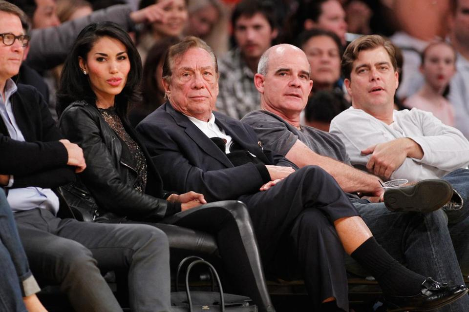Los Angeles Clippers owner Donald Sterling with V. Stiviano, to whom racist remarks were allegedly directed.