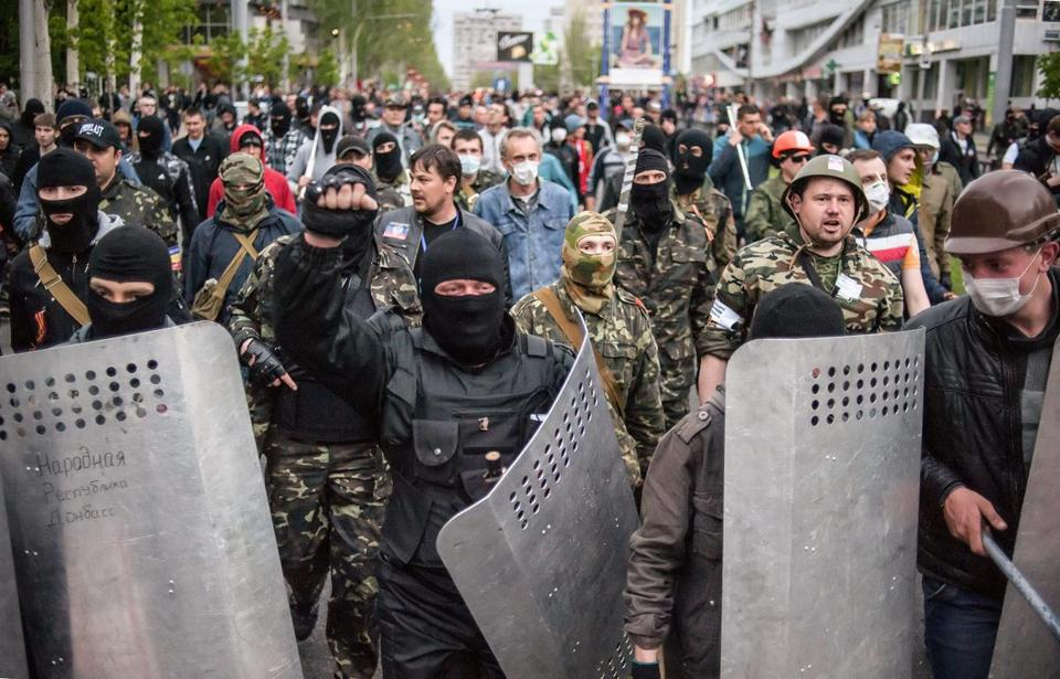 Pro-Russian protesters clashed with pro-Ukrainian supporters during a rally Monday in Donetsk, Ukraine.