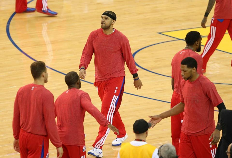 Jared Dudley (middle), a Boston College product, and other Clippers hid the team name during warmups.