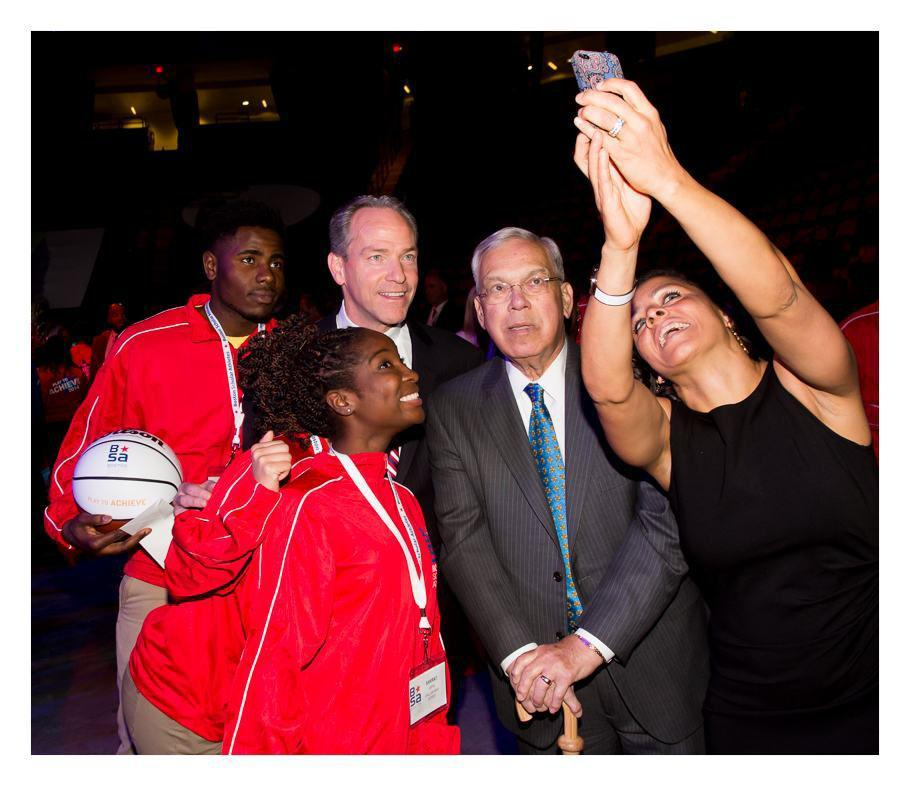 Bekah Splaine Salwasser takes a selfie with John Fish, former mayor Tom Menino, and students at the Boston Scholar Athletes Gala.