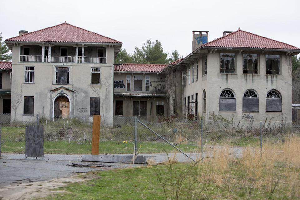 The former Plymouth County Hospital in Hanson has sat idle for more than two decades, and is a safety hazard because of damage by vandalism, fires, and general decay.