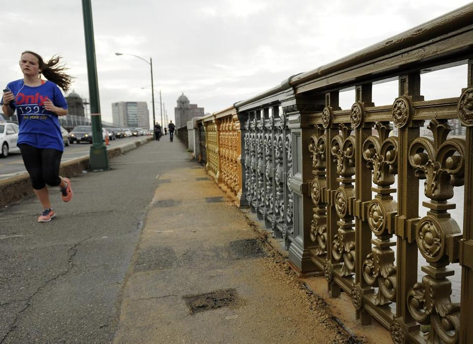 Sections of the Longfellow Bridge railing were painted different colors to determine the historically accurate hue.