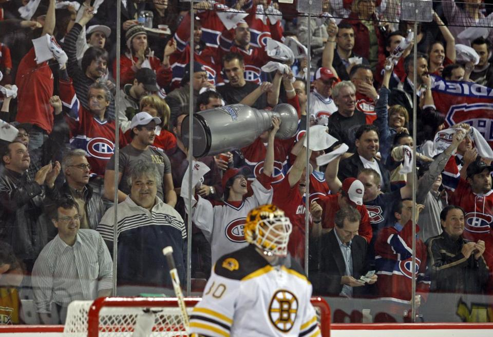 With former Bruins goalie Tim Thomas in net, Canadiens fans saluted their team during a 2008 playoff game in Montreal.