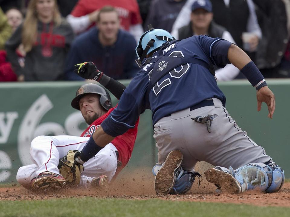 Dustin Pedroia is tagged out Rays catcher Jose Molina trying to score the tying run in the seventh inning. Matthew J. Lee/Globe staff