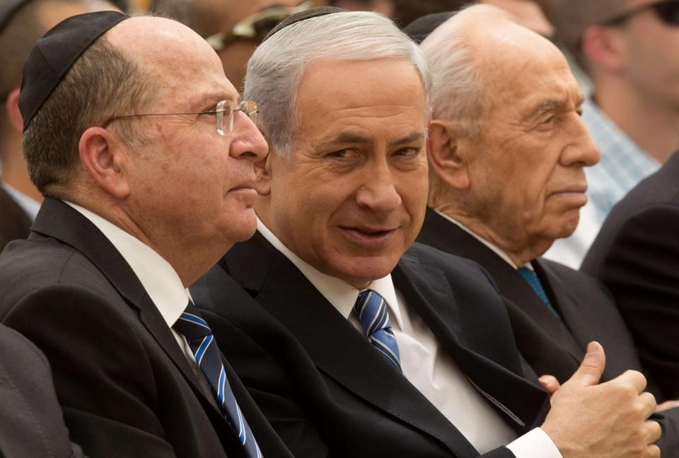 Israeli Prime Minister Benjamin Netanyahu, center, President Shimon Peres, right, and Defense Minister Moshe Ya'alon attended a ceremony last month in Jerusalem.