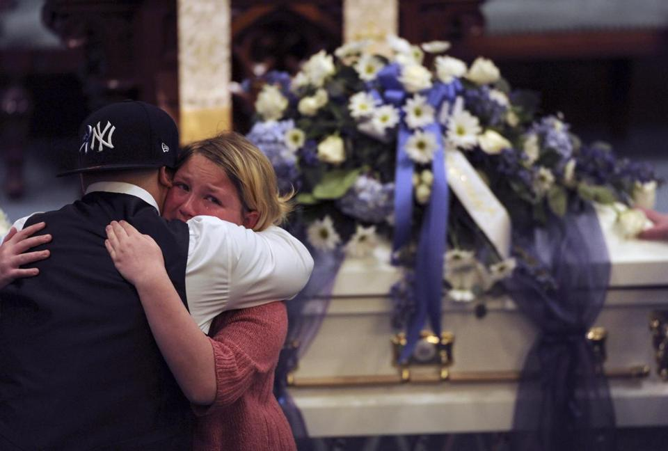 Jose Oliver, the father of Jeremiah Oliver, received a comforting hug during the funeral services at Rollstone Congregational Church in Fitchburg.