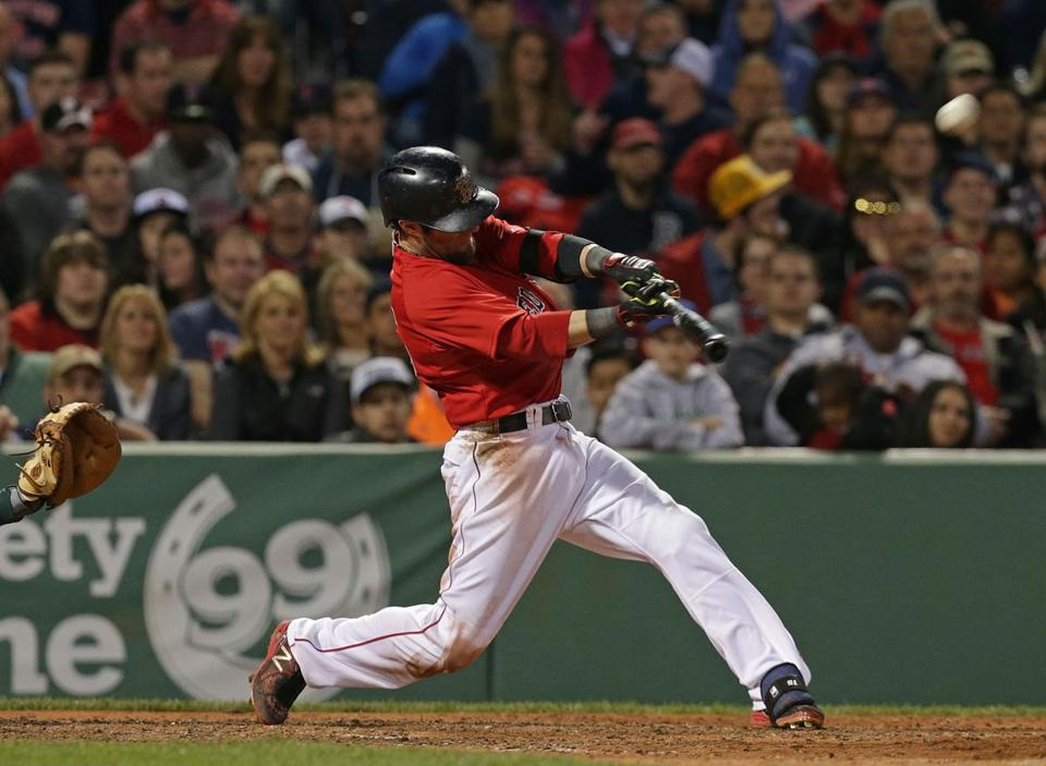 Dustin Pedroia hit a grand slam in the sixth inning against the A's.