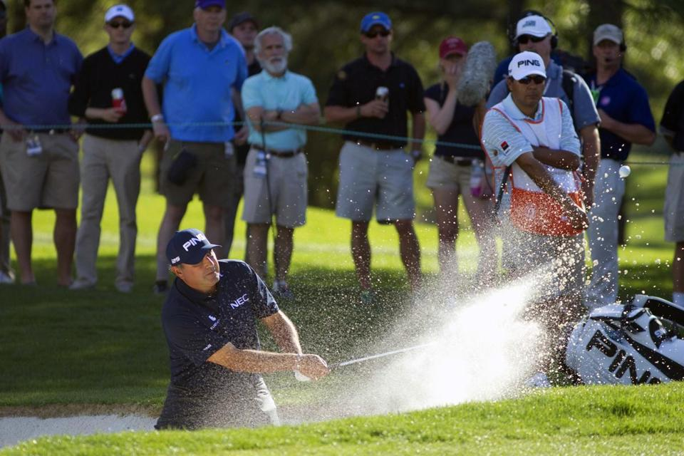 Angel Cabrera hit from a sand trap on the ninth green during Friday's second round.