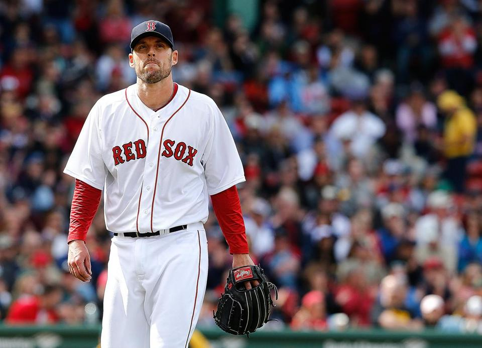 John Lackey reacted at the end of the sixth inning after giving up a run.