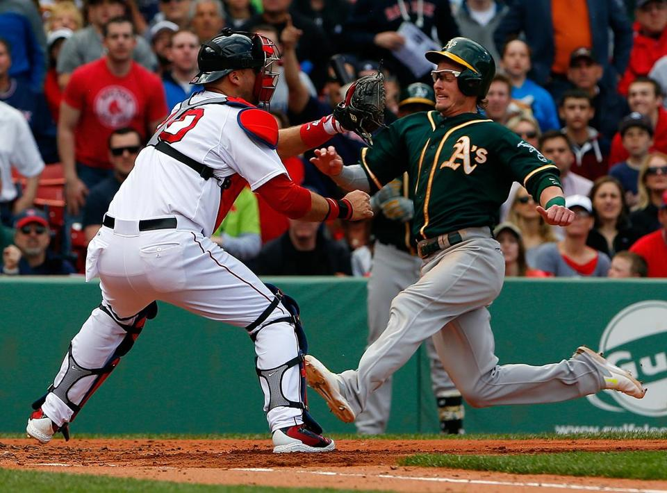 A.J. Pierzynski tagged out Josh Donaldson in the third inning at Fenway Park on Sunday.