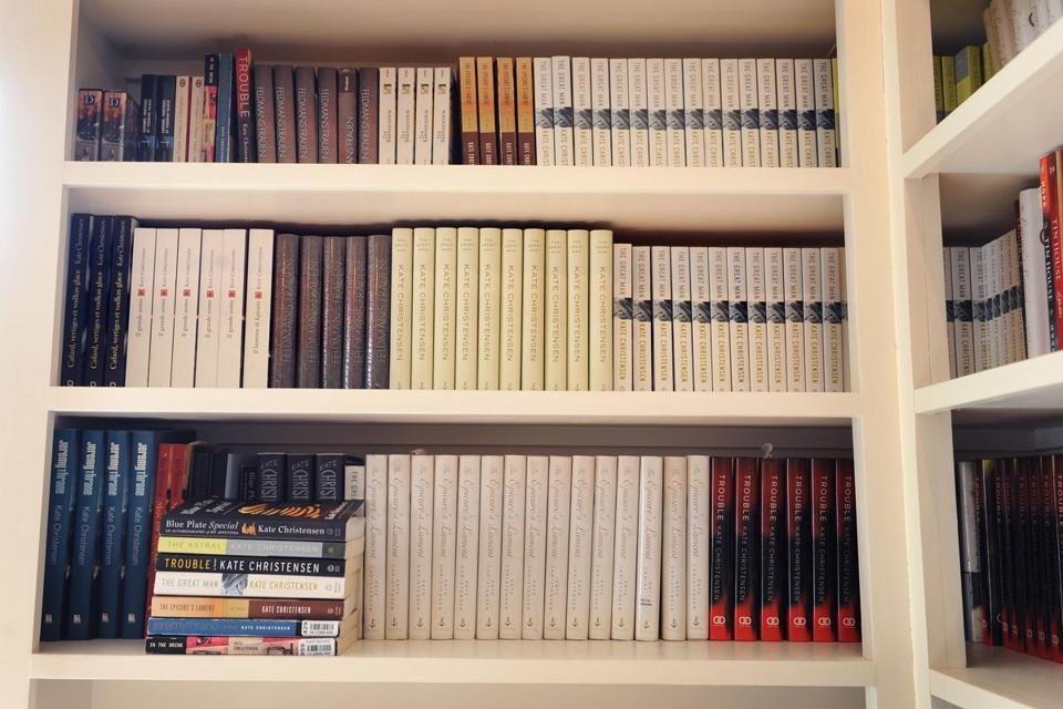 Kate Christensen keeps her books on a shelf that is visible for inspiration.