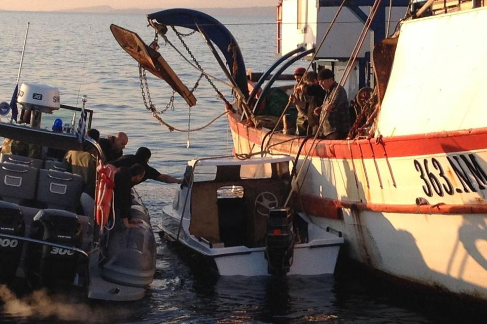 The Hellenic Coast Guard towed a small boat used by migrants trying to reach Europe.