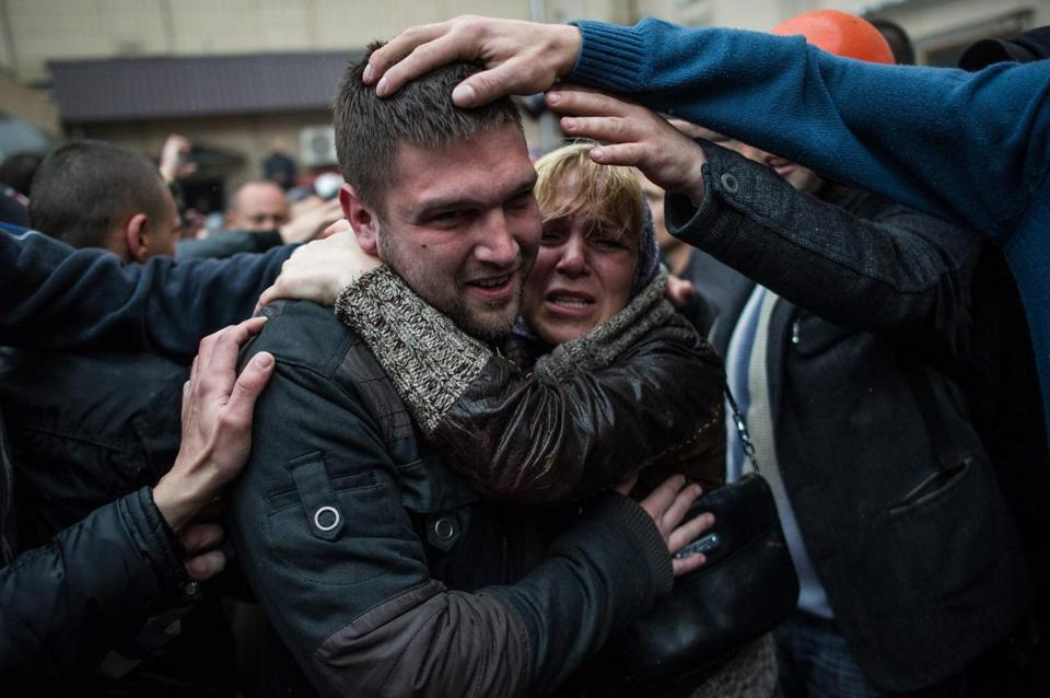 A pro-Russian supporter was greeted by supporters who were freed from detention at a police station in Odessa Sunday.