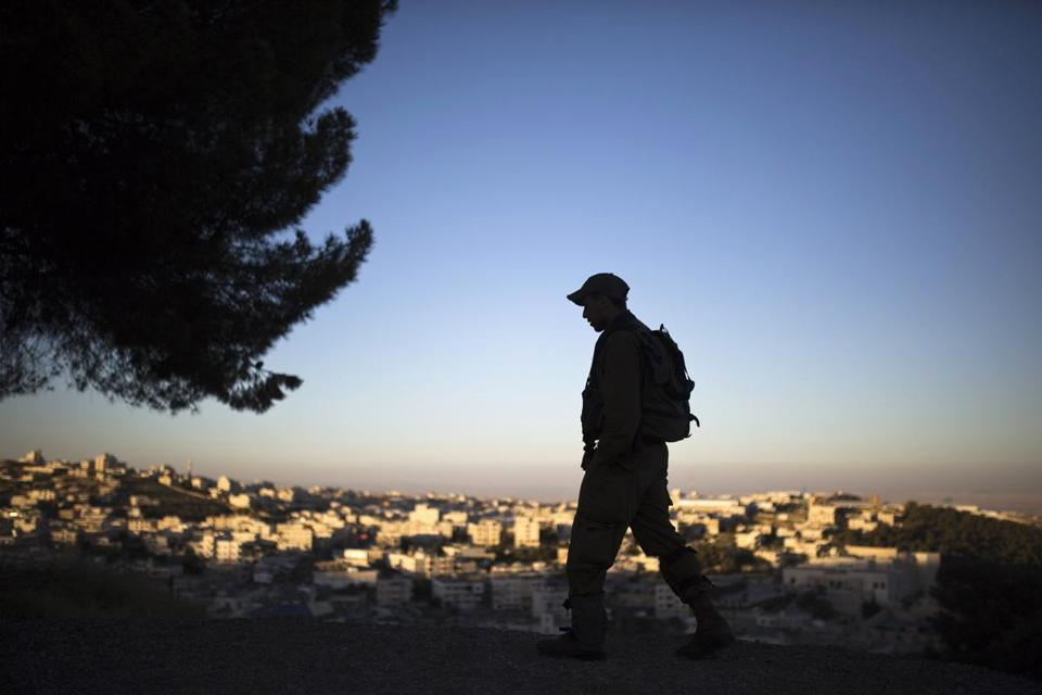 An Israeli soldier was silhouetted as he guarded a post overlooking Bethlehem last month.
