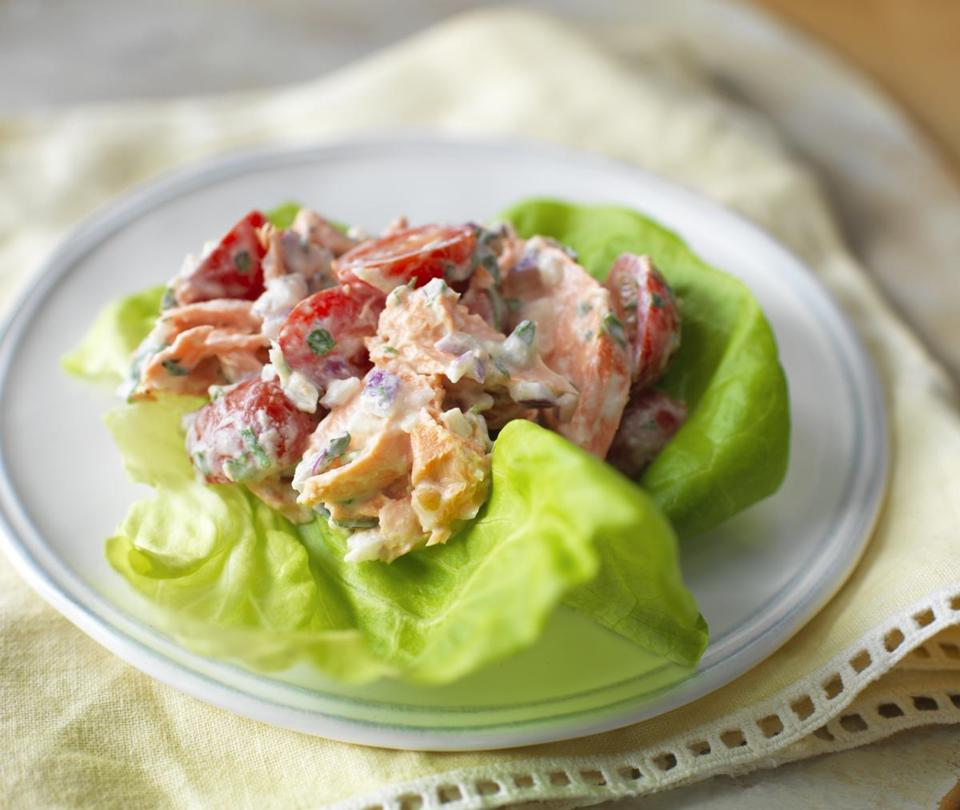 Salmon salad with tomato and basil.