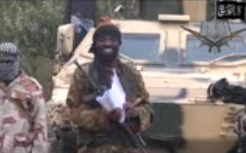 This file photo shows a still image from a video of the leader of the Islamist extremist group Boko Haram, Abubakar Shekau, delivering a speech.
