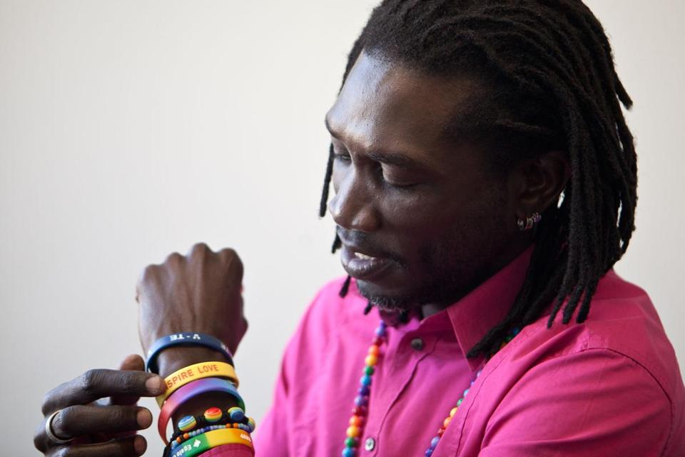 John Abdallah Wambere's bracelets symbolize his pride, activism, and connection to Africa.