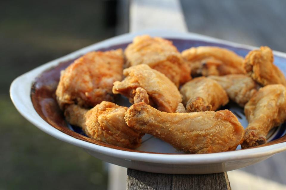 MAY 09 ,2014- ACTON, MA.- A platter of just fried fried chicken. Fried chicken Hoppin John, pickled shrimp, cheese sticks by John and Barbara Willis, originally from Charleston, SC, now living in Acton. (globe staff photo :Joanne Rathe section: food reporter Michael Floreak topic: )