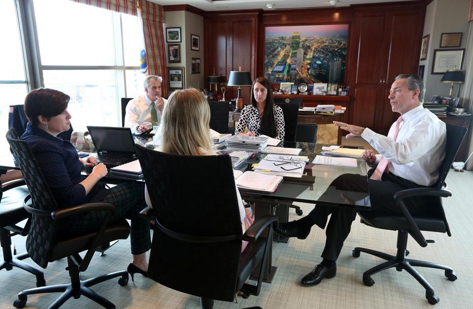 John Fish led a work meeting with his team at Suffolk Construction in May. Fish has grown from a child who had difficulty in school to a businessman leading Boston's Olympic bid.