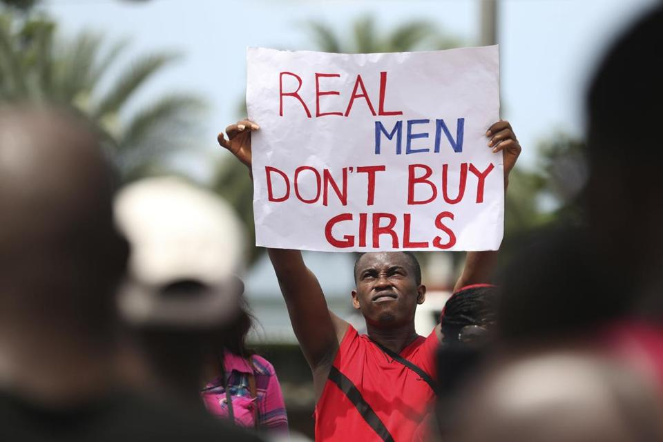 Youths in the remote village of Chibok staged a protest Saturday over the abduction of 276 girls by the Boko Haram militant group, which has threatened to sell them.
