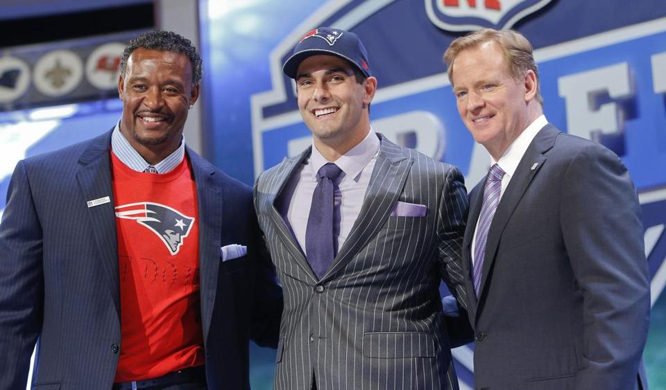 Eastern Illinois quarterback Jimmy Garoppolo (center) posed with NFL Commissioner Roger Goodell (right) and former Patriots linebacker Willie McGinest after being selected by New England in the second round.