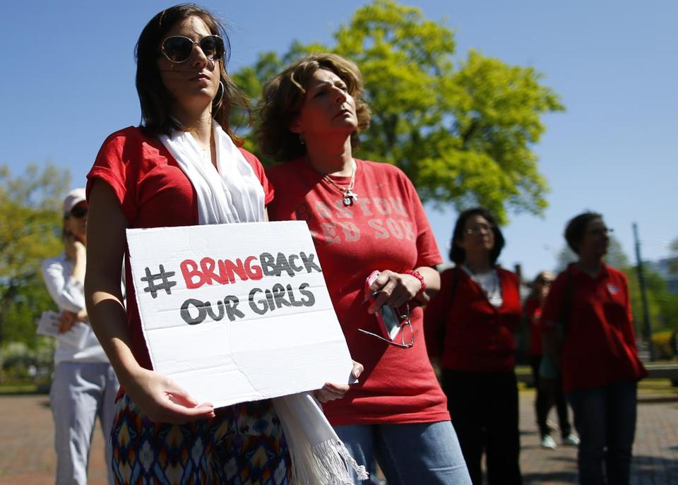 Mia Twieraga of Plymouth held a sign that said #BringBackOurGirls, the social media rallying cry of the movement to rescue Nigerian schoolgirls who were abducted Boko Haram, an Islamic militant group.