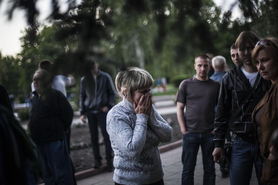 Forces identified as Ukraine security officers opened fire on Ukrainians outside a town hall in Krasnoarmeisk on Sunday. At least one person reportedly was killed.