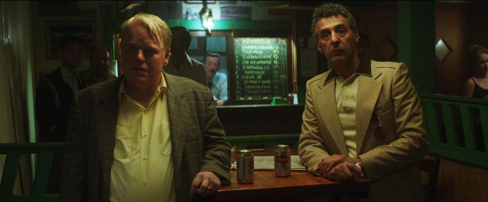 "Phillip Seymour Hoffman (left) and John Turturro in ""God's Pocket."""