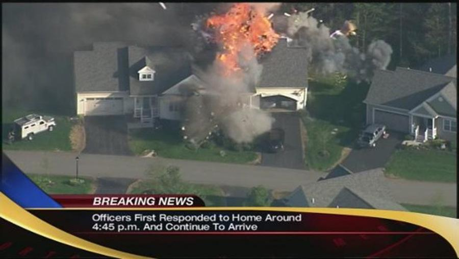A fire and explosion raged through a home in southern New Hampshire Monday afternoon.