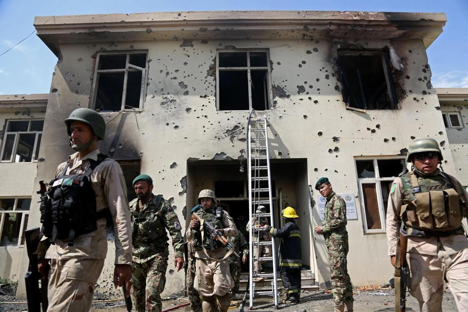 Afghan security personnel surrounded a government building after Taliban fighters stormed it in Jalalabad.