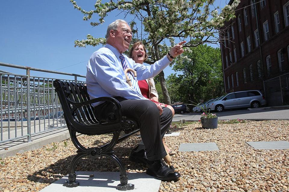 Thomas M. Menino, former mayor of Boston, sat with Debbie Rambo, president of Catholic Charities. An honorary bench was dedicated to him for his unwavering support for the Teen Center at St. Peter's.