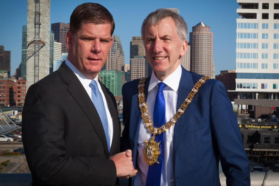 Mayor Martin Walsh and his Belfast counterpart, Máirtín Ó Muilleoir, outside the Seaport Hotel after they signed a sister city agreement. The Lord Mayor's chain of office weighs 14 pounds.